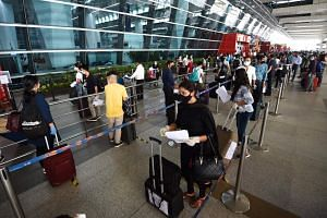 Passengers check in outside the Indira Gandhi International airport in New Delhi, on May 25, 2020.