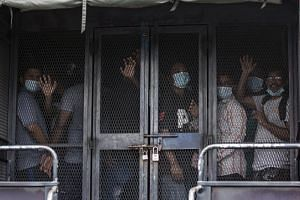 Migrant workers being transferred to a detention centre after a raid in Petaling Jaya, Malaysia, on May 20, 2020.