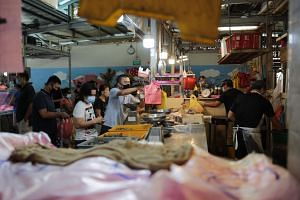 Shoppers at Whampoa Wet Market on May 28, 2020.