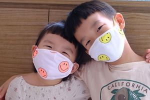 Oh Happy Fry founder Rae Yun started selling masks when she couldn't find suitable washable versions for her kids, Nicco Low (left) and Low Junjie.