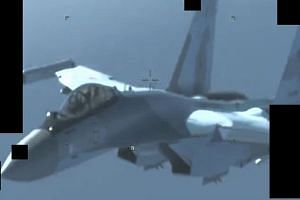 A surveillance image showing what is described as a Russian warplane deployed to Libya.