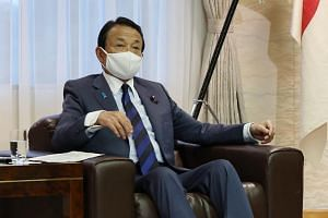 Not everyone agreed with how Finance Minister Taro Aso framed his comments.