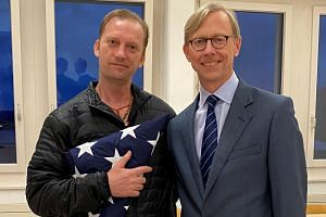 Freed US Navy veteran Michael White (left) with US Special Envoy for Iran Brian Hook.