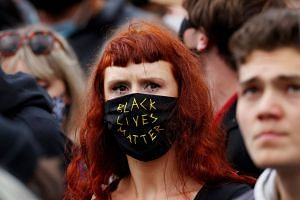 A demonstrator wearing a protective face covering marches in a Black Lives Matter protest in Manchester, Britain, June 6, 2020.