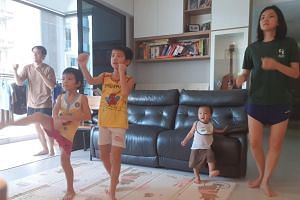 The Goh family doing a Body Combat workout together.