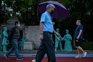 People walking along Hankou Park in Wuhan, on May 25, 2020.