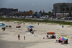 People at a beach in Galveston, Texas, US, on May 22, 2020.