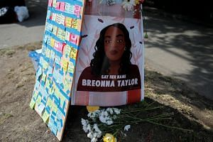 A portrait of Breonna Taylor is posted beside messages on sticky notes in Seattle, Washington, on June 10, 2020.