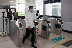 Indonesian President Joko Widodo visits an MRT station in Jakarta on May 26, 2020.