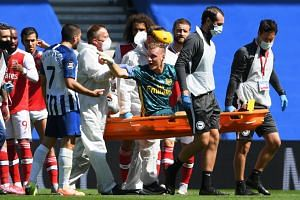 Leno reacts towards Brighton's Neal Maupay as he is stretchered off.