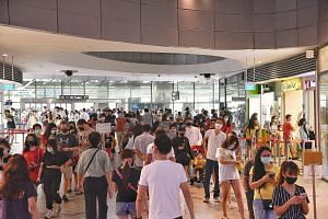 A large crowd of people waiting to enter Waterway Point in Punggol on Saturday. Experts have expressed concern over the way people have been going out and about. They still recommend staying at home, but well-ventilated and uncrowded places are a bet