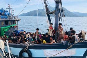 In a photo taken on April 5, 2020, a boat carrying suspected Rohingya migrants is detained in Malaysian territorial waters, in Langkawi.