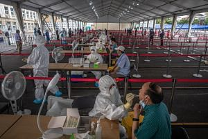 People are tested for Covid-19 at a makeshift coronavirus testing center, in Beijing, on June 24, 2020.