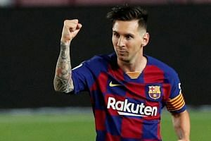 Lionel Messi celebrates scoring for Barcelona against Atletico Madrid.
