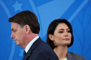 Brazil's Jair Bolsonaro and his wife Michelle at an event in Brasilia in April 2020.