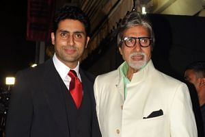A 2013 photo shows Abhishek Bachchan (left) and his father, Amitabh, attending an event in Mumbai, India.