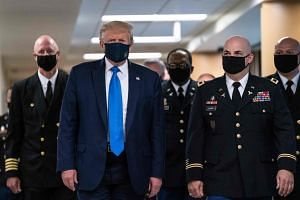 President Donald Trump wears a mask as he visits Walter Reed National Military Medical Centre on July 11.