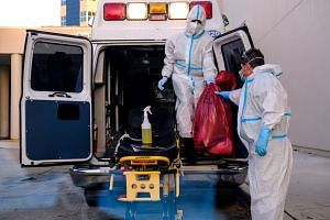 Medical staff clean their materials outside a Florida hospital where Covid-19 patients are treated on July 13, 2020.