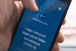 A Swedish version of the Covid Symptom Tracker app is seen on a smartphone.