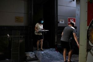 A woman moves equipment into a U-Haul truck at the Chinese consulate in Houston on July 24, 2020.