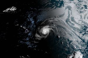 Hurricane Douglas approaches the Hawaii Islands (left) as a Category 3 storm, packing winds of 193kmh.