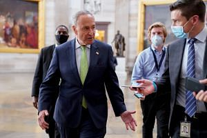 US Senate Minority Leader Chuck Schumer speaks to reporters at the US Capitol in Washington, July 29, 2020.