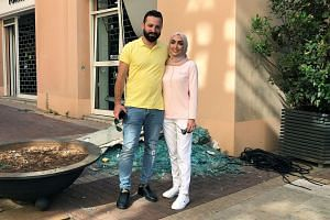 Bride Israa Seblani poses for a picture with her husband Ahmad Subeih on Aug 5, 2020, in the same place they were standing when the blast hit.