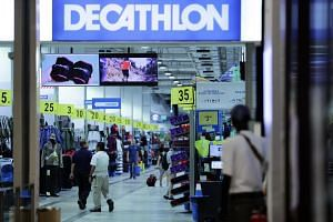Shoppers walk in the Decathlon at Joo Koon on Aug 22, 2019.