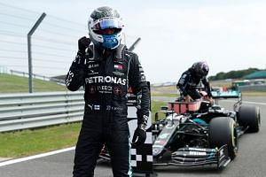 Valtteri Bottas celebrates after qualifying in pole position at the Silverstone Circuit in Britain, on Aug 8, 2020