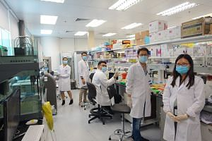 ImmunoScape's operations and development team at its laboratory in Biopolis. The $15 million fund injection will support the company's multiple projects, a key one being partnering vaccine development firms and research groups to analyse the body's i