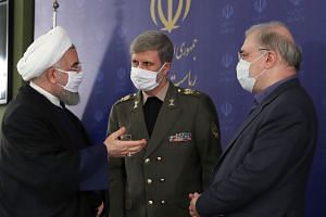 (From left) Iran's President Hassan Rouhani, Defence Minister Brigadier General Amir Hatami and Minister of Health Saeed Namaki.