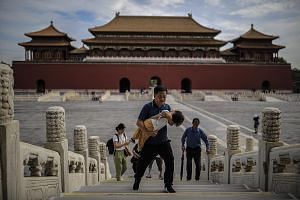 Visitors to the Forbidden City in Beijing on Wednesday seen without masks outdoors. China has reported no new locally transmitted cases on the mainland for five days after successfully controlling flare-ups in Beijing, the Xinjiang region and elsewhe