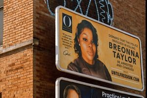A billboard featuring a picture of Breonna Taylor and calling for the arrest of police officers involved in her death in Louisville, US, on Aug 11, 2020.