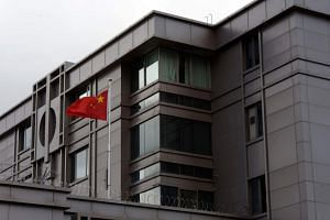A file photo shows the Chinese flag outside China's consulate in Houston which has been ordered to shut by the US government.