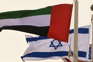 The Emirati, Israeli and US flags sway in the wind at Abu Dhabi airport on Aug 31, 2020.