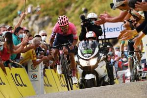 Fans cheer Colombian rider Daniel Felipe Martinez as he wins the 13th stage of the Tour de France.