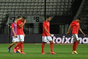 Benfica players look dejected after the match.
