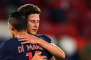 Draxler celebrates his goal with Paris Saint-Germain's Argentine midfielder Angel Di Maria.
