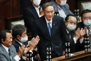 Mr Yoshihide Suga acknowledging lawmakers after he was elected Japan's prime minister on Sept 16, 2020.