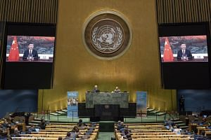 A UN photo shows Xi Jinping (on screens) addressing the 75th General Assembly of the UN in New York.