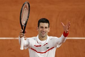 Djokovic celebrates after winning his third-round match against Colombia's Daniel Galan.