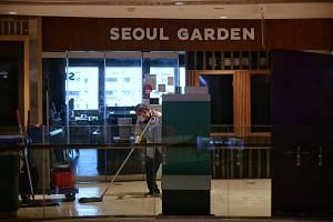 The man had dinner with 12 family members at Seoul Garden in Tampines Mall on Nov 21.