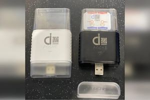 The Quiz PCR biochip and the Poche USB dongle, which controls some of the processes on the biochip.