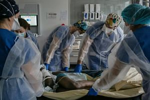 A Covid-19 patient in intensive care at Pitie-Salpetriere University Hospital in Paris, on Dec 9, 2020.