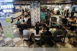 Diners at the United Square Food Junction on the first day of Singapore's phase three reopening, on Dec 28, 2020.