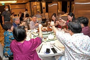 Mrs Laura Hwang (fourth from right) celebrating her birthday with her family at a restaurant in Orchard Rendezvous Hotel on Dec 28, 2020.