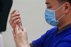 A senior staff nurse preparing the vaccination for his fellow healthcare workers at NCID in Singapore, on Dec 30, 2020.