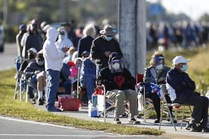 People wait in line for the Covid-19 vaccine in Lehigh Acres, Florida, on Dec 29, 2020.