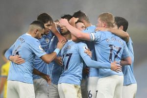 Manchester City's Phil Foden celebrates scoring their first goal with teammates in Britain on Jan 13, 2021.