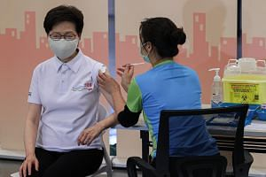 Chief Executive Carrie Lam received the coronavirus shots at a community vaccination centre in Hong Kong's main library.